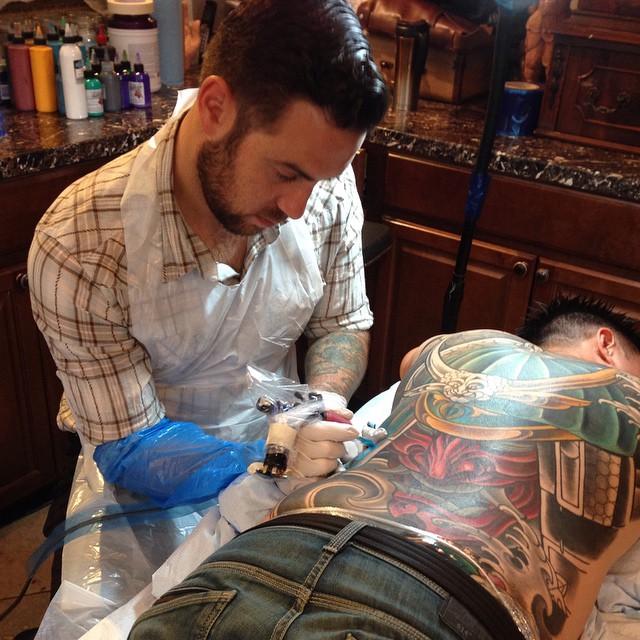 Terry Ribera @terryribera in action at Remington Tattoo #remingtontattoo #backpiece #wip