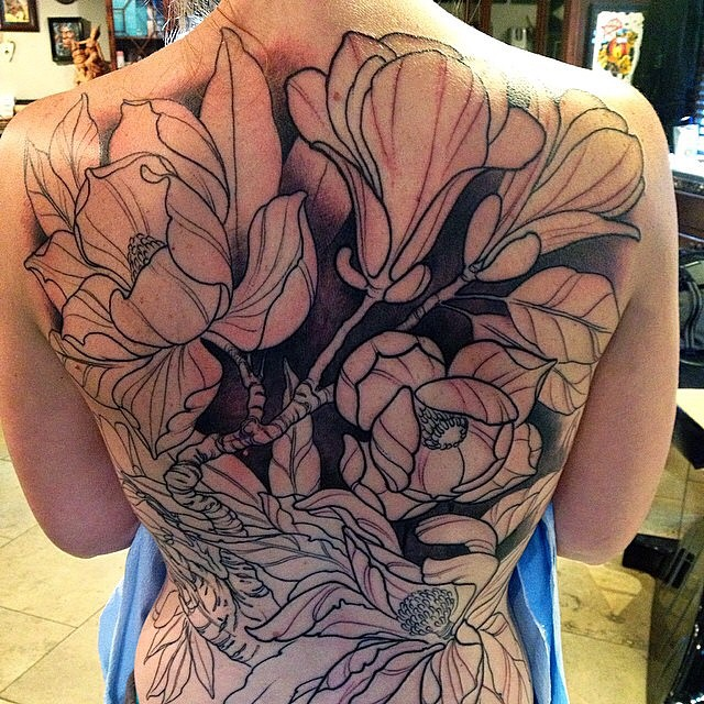 Magnolia back piece in progress by Nathaniel Gann @nathanieltattoosd at Remington Tattoo #remingtontattoo #magnoliatattoo #backpiece #flowertattoo