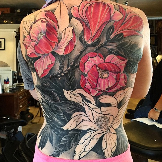 Progress shot of this Magnolia back piece by Nathaniel Gann @nathanieltattoosd #magnoliatattoo #flowertattoo #prettytattoo #backtattoo #wip