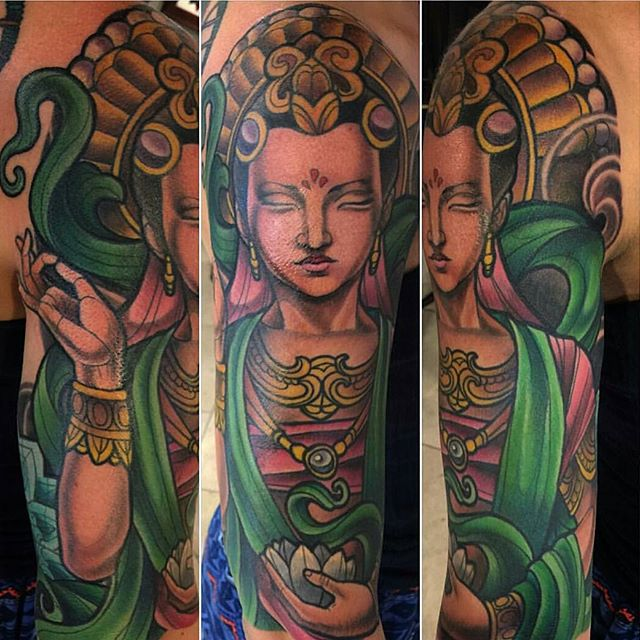 Full Color Guanyin Upper Arm Tattoo by Terry Ribera