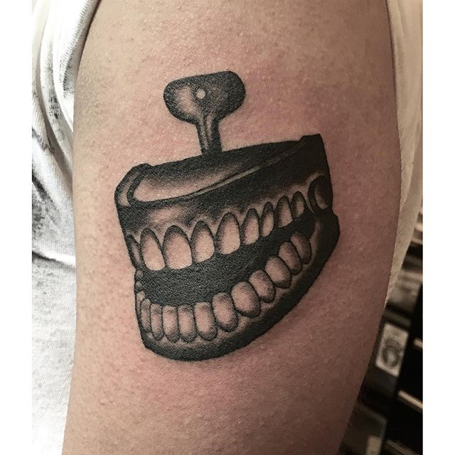 Chattering teeth tattoo by @jasmineworth to book a tattoo with Jasmine, please contact her at JasmineWorthTattoos@gmail.com #joketeeth #chatteringteethtattoo #toothtattoo #teethtattoo #joketattoo